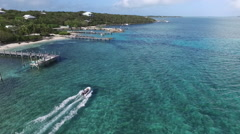 AERIAL: Small Inflatable Boat Tropical Island Bahamas Stock Footage