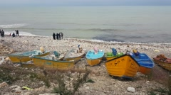 Rear top view of Iranian men women wearing Islamic hijab looking at Caspian sea - stock footage
