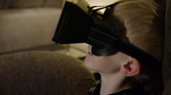 Oculus Rift - Child playing video games in virtual reality Stock Footage
