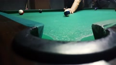 Stock Video Footage of Sinking ball number 10 with a soft shot in billiard pocket in an eight ball game