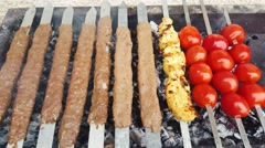 Persian Turkish food on grill-Adana Kebab- Kebab Kobideh - Joje Kebab and Tomato Stock Footage