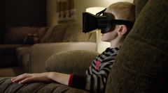 Young boy wearing virtual reality headset Stock Footage