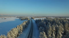 Aerial view at the winter road with windmills Stock Footage