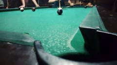 Sinking ball number 4 with spider rest head in billiard pocket in eight ball - stock footage
