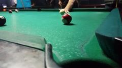 Sinking the ball number 11 with hard shot to billiard pocket in eight ball game Stock Footage