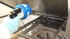 Application of detergent on the saw for the meat. Stock Footage