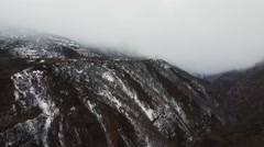 CHALUS, IRAN: A pan right to left of a snowy and foggy beautiful mountain Stock Footage