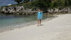 Young girl walks along the beach. - stock footage