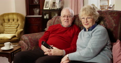 Senior couple watching their favourite television show at home. Shot on RED Epic - stock footage