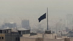 The black flag of Islam in an Islamic city in a super windy snowy day. Stock Footage