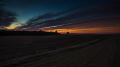 4k timelapse of sunrise over plowed field at frosty morning Stock Footage