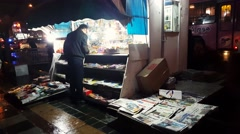 A man buying Iranian newspapers from a newsstand-Political Social economic Sport Stock Footage