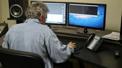VIDEO EDITOR AT WORK 4K - stock footage