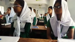 Portrait of Muslim Bangladeshi students at school-responding to teacher-Asia Stock Footage