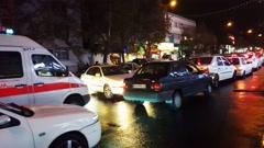 Ambulance & police car stuck in traffic jam in Tehran capital of Iran at night Stock Footage