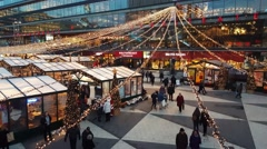 People walking and shopping in a Christmas market during Christmas and new year - stock footage