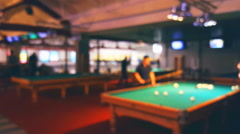 Blurred background, man playing billiards on several tables Stock Footage
