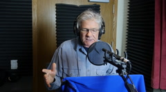 MAN IN VOICE-OVER BOOTH WITH DOLLY MOVE Stock Footage