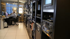 MAN WORKS IN TELEVISION CONTROL ROOM Stock Footage