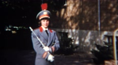 1952: Shy teenage marching band member blue captain suit flute player. DENVER, Stock Footage