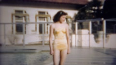 1952: Teenage girl old timey bathing suit walking around at country club pool. Stock Footage