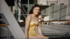 1952: Teenage girl old timey bathing suit seated at country club pool. DENVER, Stock Footage
