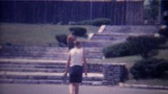 1966: Teenage boys visit wood tree log style fort museum recreation.  Stock Footage