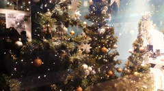 Reflection of people over Christmas tree on showcase of shop during new year Stock Footage