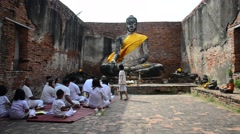 Thai people praying with buddha statue at Wat Worachet Tharam temple Stock Footage