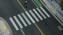 moped crossing the zebra walk seen from above - stock footage