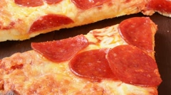 Zoom out shot of sliced pizza Stock Footage