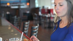 Attractive young woman in a cafe - stock footage
