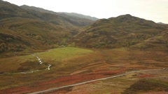 Scotland small road and stream Stock Footage