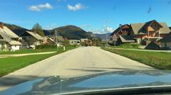 Driving through small alpine village Kamnje, Slovenia. Stock Footage