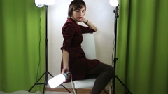 Beautiful emotional model posing at camera with light equipment Stock Footage