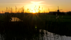 Beautiful Sunset shot of a Dutch Windmill in the polder at Kinderdijk the Nether Stock Footage