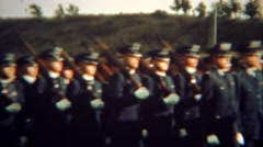 1966: Armed soldiers marching in perfect sync with shouldered rifle guns. U.S. Stock Footage
