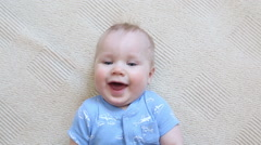 Baby looks around and then smiles and laughs Stock Footage