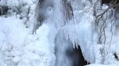 Frozen water stream in the countryside Stock Footage