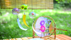 Japanese traditional paper fan and wind chimes - stock footage