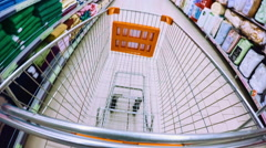 POV: Walking in the shop with shopping cart - stock footage