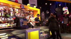 People buying game zone ticket inside cineplex game section Stock Footage
