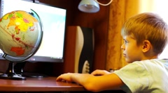 Child is doing on the computer Stock Footage