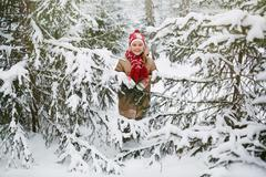 Girl by winter trees Stock Photos