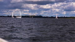 Sailboats sailing on Mamary lake in Mazury lake district Stock Footage