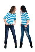 Two vigorous girls in striped vests Stock Photos