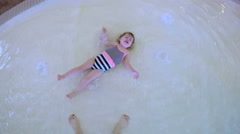 Toddler girl swimming in indoor pool. Stock Footage