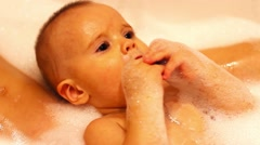 Child in foam Stock Footage