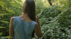 Girl goes on the path in the forest Stock Footage