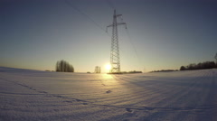 Sunset in the field with electrical pylon in winter, time lapse 4K Stock Footage